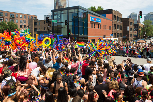 Pride Parade marching through the heart of Chicago's Boystown neighborhood